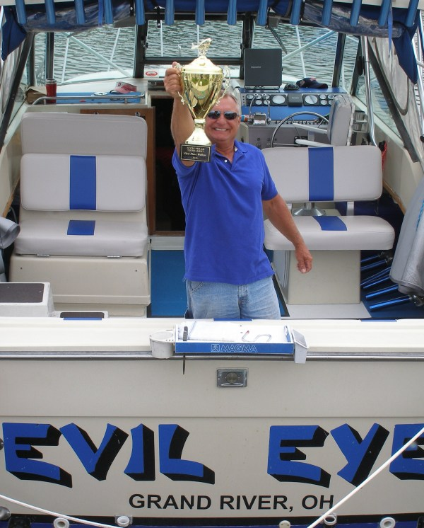 Captain Marv of Evil Eye Charters poses with first place trophy for winning 2010 NCCBA Lake Erie Walleye Fishing Tournament