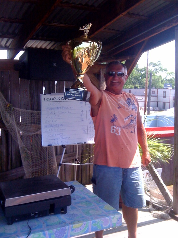 Captain Marv of Evil Eye Charters at the scales wins the 2010 NCCBA Lake Erie Walleye Fishing Tournament