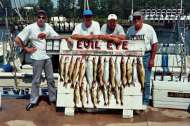 Lake Erie fishing charter group poses with a good catch for the day.