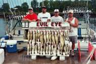 Evil Eye clients show off a great catch of fish.