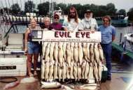 A group of six display their limit of 30 walleye.
